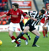 Photo: Dave Linney.<br />Walsall v Rotherham United. Coca Cola League 1.<br />26/11/2005.Eric Skora( Walsall)  battles for the ball with Paul Mclaren(Rotherham)