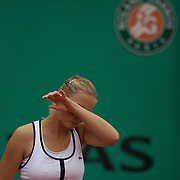Jelena Dokic of Australia in action against Elena Dementieva of Russia before retiring injured while leading during the second round of the French Open Tennis Tournament in Paris, France on Thursday, May 28, 2009. Photo Tim Clayton.