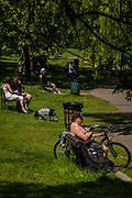 Some people ignore the 'brief' part of teh eased instruction on using the benches - Clapham Common is not that busy despite the sun being out and that now people are allowed to sit, if only briefly, on the benches. The 'lockdown' continues for the Coronavirus (Covid 19) outbreak in London.