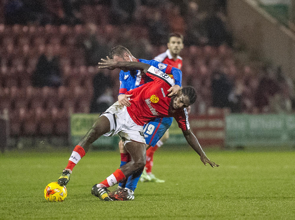 Crewe Alexandra's Anthony Grant holds off the challenge from Doncaster Rovers' Richard Wellens<br /> <br /> Photographer Marty Hill/CameraSport<br /> <br /> Football - The Football League Sky Bet League One - Crewe Alexandra v Doncaster Rovers - Saturday 29th November 2014 - Alexandra Stadium - Crewe<br /> <br /> © CameraSport - 43 Linden Ave. Countesthorpe. Leicester. England. LE8 5PG - Tel: +44 (0) 116 277 4147 - admin@camerasport.com - www.camerasport.com