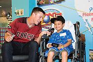 PHOENIX, AZ - JUNE 07: Jake Lamb and Archie Bradley visit patients at Phoenix Children's Hospital. (Photo by Sarah Sachs/Arizona Diamondbacks)