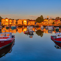 New England working harbor scenery of harbor fleat during the sunrise hours at Rockport Harbor on Cape Ann, Massachusetts.<br /> <br /> Rockport Harbor morning bliss photography images are available as museum quality photo, canvas, acrylic, wood or metal prints. Wall art prints may be framed and matted to the individual liking and New England interior design projects decoration needs.<br /> <br /> Good light and happy photo making!<br /> <br /> My best,<br /> <br /> Juergen