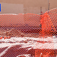 110112       Cable Hoover<br /> <br /> An old handicapped parking sign protrudes from a network of construction fencing at the Presbyterian Medical Services Clinic in Gallup Thursday.