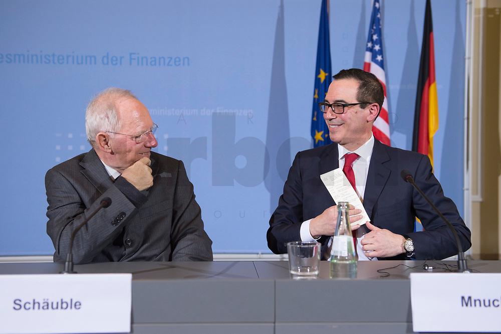 """16 MAR 2017, BERLIN/GERMANY:<br /> Wolfgang Schaeuble (L), CDU, Bundesfinanzminister, und Steven Terner """"Steve"""" Mnuchin (R), Fianzminister der Vereinigten Staaten von Amerika, USA, im Gespraech, nach einer Pressekonferenz nach einem gemeinsamen Treffen, Bundesministerium der Finanzen<br /> IMAGE: 20170316-03-032<br /> KEYWORDS: Wolfgang Schäuble, Steve Mnuchin, Treasury secretary, Gespräch"""
