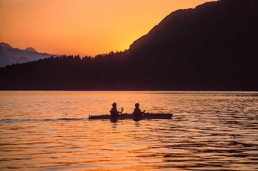Sea kayaking, Hugh Miller Inlet, evening light, Glacier Bay National Park, Alaska, USA