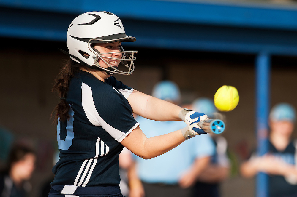 MMU's Rylee LeBourveau hits the ball during the girls softball game between BFA-St. Albans and Mount Mansfield at MMU High School on Thursday afternoon May 8, 2014 in Jericho, Vermont. (BRIAN JENKINS, for the Free Press)