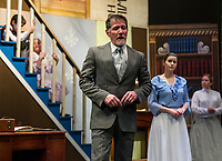 """Rodney Martel and Merdith Imbimbo as George and Winifred Banks with Kelli Powers as Mary Poppins and the children Jane and Michael on the stairs played by Isabella Cottrell and Jesse Powers during dress rehearsal for The Streetcar Company production of """"Mary Poppins"""" at Interlakes High School auditorium.  (Karen Bobotas/for the Laconia Daily Sun)"""