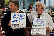 "Greeting drivers await their passengers to arrive off a flight from Beijing. In the hectic international arrivals concourse of Heathrow's Terminal 5, the men hold up name boards to attract the attention of those Chinese nationals who are new students at a Bournemouth language college called Education First (EF), based on England's south coast. From writer Alain de Botton's book project ""A Week at the Airport: A Heathrow Diary"" (2009)."