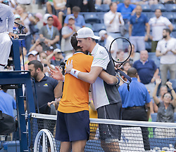 September 4, 2018 - New York, New York, United States - Juan Martin del Potro of Argentina & John Isner of USA embrace each other after US Open 2018 quarterfinal match at USTA Billie Jean King National Tennis Center (Credit Image: © Lev Radin/Pacific Press via ZUMA Wire)