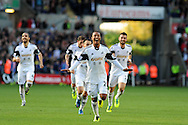Swansea city's Jonathan de Guzman © celebrates after he scores his sides 2nd goal. Barclays Premier league match, Swansea city v Sunderland at the Liberty Stadium in Swansea, South Wales on Saturday 19th Oct 2013. pic by Andrew Orchard, Andrew Orchard sports photography,