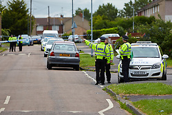 © Licensed to London News Pictures.  24/06/2013. AYLESBURY, UK. Police officers at the scene of a suspicious death in Aylesbury, Bucks. Thames Valley Police were called to a property in Belgrave Road, next to a local primary school,  at 10:43 last night (Sunday)and a man's body was found inside. The death is being treated as unexplained but suspicious. Photo credit: Cliff Hide/LNP