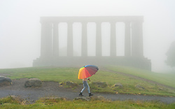 Edinburgh, Scotland, UK. 13 June 2020. A thick fog ,or haar as it is called locally, covers the city and obscures the famous tourist viewpoint from Calton Hill. Normally the viewpoint is busy with tourists , however, with the fog and Covid-19 lockdown continuing, only a few members of the public ventured up the hill today. Iain Masterton/Alamy Live News