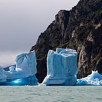 Amazing blue sculptures lightened under the evening sun. Parque Nacional Los Glaciares was declared World Heritage Site in 1981.