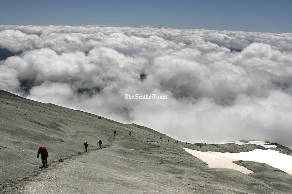 Hikers walk up the last pitch of volcanic ash and pumice from the 1980 eruption before reaching the 8,350-foot elevation and the edge of Mount St. Helens' crater. (Steve Ringman / The Seattle Times, 2006)