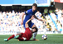 Liverpool's Mohamed Salah and Chelsea's Gary Cahill battle for the ball