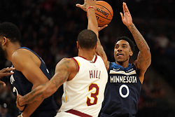October 19, 2018 - Minneapolis, MN, USA - The Minnesota Timberwolves' Jeff Teague (0) shoots over the head of the Cleveland Cavaliers' George Hill (3) in the first half on Friday, Oct. 19, 2018, at the Target Center in Minneapolis. (Credit Image: © Anthony Souffle/Minneapolis Star Tribune/TNS via ZUMA Wire)