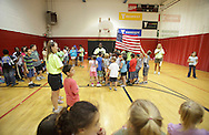 Middletown, New York - Children and counselors from the Middletown YMCA summer camp say the Pledge of Allegiance at the start of the day on August 20, 2010.