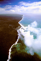 aerial view of coast line at Kilauea, creation of new land - hot lava flows into cold ocean creating large steam clouds, Hawaii Volcanoes National Park, Kilauea, Big Island, Hawaii, Pacific Ocean..