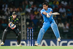 © Licensed to London News Pictures. 28/09/2012. Indian captain M.S Dhoni batting during the T20 Cricket World cup match between Australia Vs India at the R.Premadasa Cricket Stadium,Colombo. Photo credit : Asanka Brendon Ratnayake/LNP