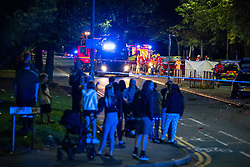 © Licensed to London News Pictures. 21/09/2021. Salford, UK. Firefighters, paramedics and police at the scene as specialists work to cut a woman free from a car following a road traffic accident, appearing to involve two cars, on Churchill Way in Salford . Photo credit: Joel Goodman/LNP