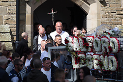 "© Licensed to London News Pictures . 28/08/2015 . Salford , UK . JOHN MASSEY (centre of church arch) , Paul Massey's brother ,  leaves the church after the service . The funeral of Paul Massey at St Paul's CE Church in Salford . Massey , known as Salford's "" Mr Big "" , was shot dead at his home in Salford last month . Photo credit : Joel Goodman/LNP"