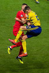 March 23, 2019 - Stockholm, SWEDEN - 190323 of Romania Dragos Grigore and Mikael Lustig of Sweden compete for the ball during the UEFA Euro Qualifier football match between Sweden and Romania on March 23, 2019 in Stockholm  (Credit Image: © Simon HastegÃ…Rd/Bildbyran via ZUMA Press)