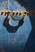 Detail of an old metal door knocker in the medina of Essaouira in Morocco