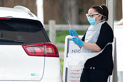 © Licensed to London News Pictures. 30/03/2020. CHESSINGTON, UK. Nurses at a  drive through Coronavirus testing site take swabs from key workers for analysis. A drive through virus testing centre for NHS staff and key workers has opened in the car park of Chessington World of Adventures in Greater London. Photo credit: Luke Dray/LNP