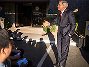 09 NOVEMBER 2013 - PHOENIX, AZ: US Representative DAVID SCHWEIKERT (R-AZ), right, talks to constituents in front of his district office in Scottsdale. Congressman Schweikert represents Arizona's 6th Congressional District. Most of the district is in Scottsdale, a wealthy suburb of Phoenix and one of the wealthiest cities in the United States. Schweikert is a staunch conservative and popular with the Tea Party. He supported the government shutdown in October.     PHOTO BY JACK KURTZ