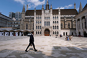 Plaza outside Guildhall on 11th August 2021 in London, United Kingdom. Guildhall is a municipal building in the Moorgate area of the City of London. The building has been used as a town hall for several hundred years, and is still the ceremonial and administrative centre of the City of London and its Corporation.