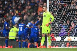 Stoke City goalkeeper Jack Butland shows his dejection as Everton celebrate scoring their sides first goal of the match during the Premier League match at the bet365 Stadium, Stoke.