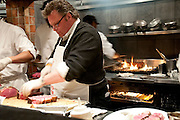 David Burke slices prime rib at Beacon Restaurant by Rodney Bedsole, a food photographer based in Nashville and New York City.