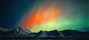 Beautiful red and green aurora over the Talkeetna Mountains during geomagnetic storm during early morning hours of October 28, 2001, Broad Pass, Alaska.