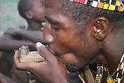 Africa, Tanzania, Lake Eyasi, Hadza man smoking from a traditional clay pipe Small tribe of hunter gatherers AKA Hadzabe Tribe April 2006