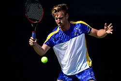 August 21, 2018 - Winston-Salem, NC, U.S. - WINSTON-SALEM, NC - AUGUST 21: Peter Gojowczyk (GER) hits a volley against Horacio Zeballos (ARG) during the Winston-Salem Open on August 21, 2018 at the Wake Forest Tennis Center in Winston-Salem, North Carolina. (Photo by William Howard/Icon Sportswire) (Credit Image: © William Howard/Icon SMI via ZUMA Press)