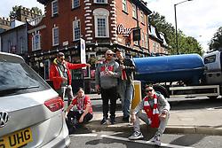 14 September 2017 -  UEFA Europa League (Group H) - Arsenal v FC Koln - FC Koln fans pose in the street on a traffic island at Highbury Corner - Photo: Mark Leech/Offside