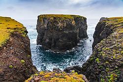 Dramatic cliffs and Moo Stack prominent  on coast at Eshaness at Northmavine , north mainland of Shetland Islands, Scotland, UK