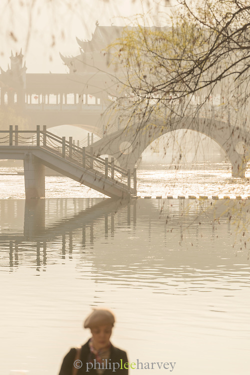 View of a traditional Chinese style arch bridge across a river, Fenghuang, Hunan Province, China