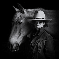 Portrait of a child with horse. Priory of Sacquenay, Burgundy, France. 100% Natural Light.