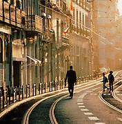 A man walking down a main street in downtown Lisbon, Portugal