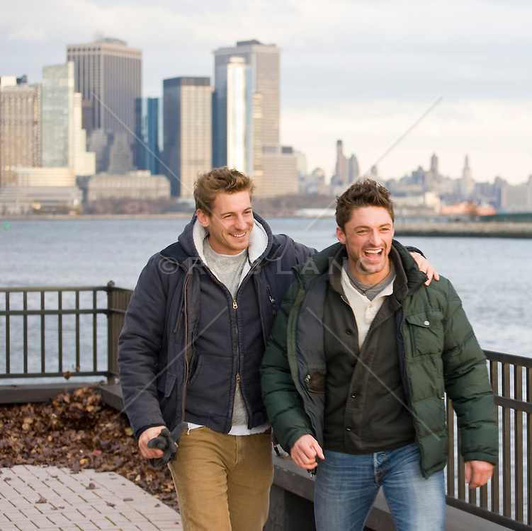 Two friends enjoying a walk together along the New Jersey side of the Hudson River