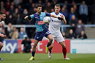 Scott Kashket of Wycombe Wanderers under pressure from Lee Brown of Portsmouth during the EFL Sky Bet League 1 match between Wycombe Wanderers and Portsmouth at Adams Park, High Wycombe, England on 6 April 2019.