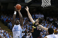 01 December 2015: North Carolina's Joel James (42) and Maryland's Michal Cekovsky (SVK) (15). The University of North Carolina Tar Heels hosted the University of Maryland Terrapins at the Dean E. Smith Center in Chapel Hill, North Carolina in a 2015-16 NCAA Division I Men's Basketball game. UNC won the game 89-81.