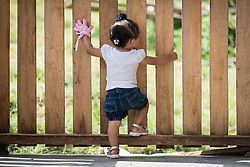 16 November 2018, San José de León, Mutatá, Antioquia, Colombia: 14-month-old Charli Stephany climbs on a fence in the community of San José de León. Born in late October 2017, the girl is just over a year old and her mother went through pregnancy at a time when the plastic that today makes the foundation of fish farming tanks, served as roofs over community members' heads. Following the 2016 peace treaty between FARC and the Colombian government, a group of ex-combatant families have purchased and now cultivate 36 hectares of land in the territory of San José de León, municipality of Mutatá in Antioquia, Colombia. A group of 27 families first purchased the lot of land in San José de León, moving in from nearby Córdoba to settle alongside the 50-or-so families of farmers already living in the area. Today, 50 ex-combatant families live in the emerging community, which hosts a small restaurant, various committees for community organization and development, and which cultivates the land through agriculture, poultry and fish farming. Though the community has come a long way, many challenges remain on the way towards peace and reconciliation. The two-year-old community, which does not yet have a name of its own, is located in the territory of San José de León in Urabá, northwest Colombia, a strategically important corridor for trade into Central America, with resulting drug trafficking and arms trade still keeping armed groups active in the area. Many ex-combatants face trauma and insecurity, and a lack of fulfilment by the Colombian government in transition of land ownership to FARC members makes the situation delicate. Through the project De la Guerra a la Paz ('From War to Peace'), the Evangelical Lutheran Church of Colombia accompanies three communities in the Antioquia region, offering support both to ex-combatants and to the communities they now live alongside, as they reintegrate into society. Supporting a total of more than 300 families, the p