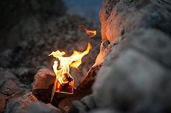 13.06.2015, Spitzkofel, Lienz, AUT, Jedes Jahr steigen Bergsteiger für die Gemeinde Leisach auf den Gipfel und die Türme des Spitzkofel um dort die Herz-Jesu-Feuer aufzustellen. Zurkückzuführen sind die Feuer auf einen in Bozen, im Jahr 1796, entstandener Brauch und hängt mit der Herz-Jesu-Verehrung zusammen Als beim Tiroler Volksaufstand Andreas Hofer´s Truppen gegen Frankreich siegreich waren wurde der Herz-Jesu-Sonntag damals zum hohen Feiertag, im Bild Feuer am Gipfel des Spitzkofel, EXPA Pictures © 2015, PhotoCredit: EXPA/ Michael Gruber