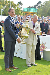 Left to right, ANDRE KONSBRUCK Director of Audi UK and HRH THE PRINCE OF WALES at the Audi International Polo at Guards Polo Club, Windsor Great Park, Egham, Surrey on 26th July 2014.