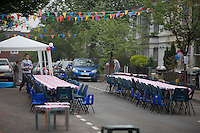 © London News Pictures. MAIDSTONE, UK 28/04/2011.The Royal Wedding of HRH Prince William to Kate Middleton. Preparations have started as the bunting comes out at The Swan pub in Wolletts Street, Maidstone, Kent. Maidstone is Britain's most patriotic borough with more street parties planned to celebrate the wedding of Prince William and Kate Middleton than anywhere else in the country. Up to 22 licences in Maidstone alone.