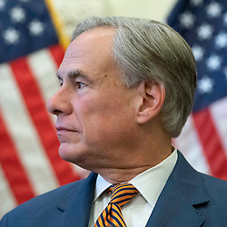 Texas Gov. Greg Abbott (c) with legislators and energy officials, signs two bills strengthening the Texas power grid and infrastructure that were emergency items on his legislative agenda. The bills were in response to February's winter storm that nearly knocked out the Texas power grid.