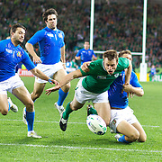 Tommy Bowe, Ireland, is held back as he attempts to score a try during the Ireland V Italy Pool C match during the IRB Rugby World Cup tournament. Otago Stadium, Dunedin, New Zealand, 2nd October 2011. Photo Tim Clayton...