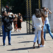 London, UK. 27 June 2019. UK Weather - A group of people taking a selfies at the Hottest week in June 2019 at Buckingham Palace, London, UK